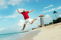Santa Claus And Wish A Happy New Year. Funny Grandfather Frost Jumps On The Sea. Royalty Free Stock Photos - 65688028