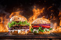 Home Made Burgers With Fire Flames. Stock Images - 65689314