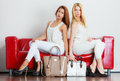 Fashionable Girls With Bags Handbags On Red Couch Royalty Free Stock Images - 65689489
