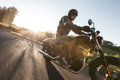 Man Seat On The Motorcycle On The Forest Road. Royalty Free Stock Photography - 65689497