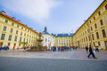 Prague, Czech Republic - 13 August, 2015: Large Yellow Beautiful Building Sorrounding Square With Big Water Fountain Stock Photography - 65696142