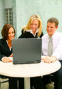 Business People Looking At Laptop Royalty Free Stock Photo - 6571225