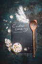 Rustic Easter Cooking Background With Chalkboard , Cake , Eggs Shell Von Quail, Wooden Spoon And Hyacinth Flower Royalty Free Stock Image - 65709816