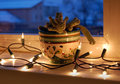 Cactus In The Window With Christmas Lights Royalty Free Stock Photo - 65710305