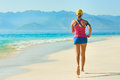 Athlete Runner Resting After Jogging Training Outdoors In Beach. Stock Photos - 65715333
