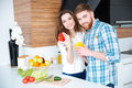 Beautiful Couple Cooking Healthy Food On The Kitchen Royalty Free Stock Photos - 65733208