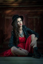 Young Beautiful Brunette Woman With Red Short Dress And Black Hat Posing Sensual In Vintage Scenery. Romantic Mysterious Lady Royalty Free Stock Photography - 65739737
