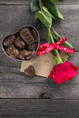 Box Of Chocolates, Red Rose On A Dark Background Stock Photo - 65740230