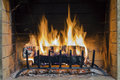 Fire In Fireplace. Closeup Of Firewood Burning In Fire. Royalty Free Stock Images - 65765219
