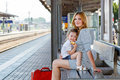 Cute Little Girl And Mother On A Railway Station. Royalty Free Stock Photos - 65799918