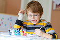 Little Kid Boy Drawing With Colorful Watercolors Indoors Royalty Free Stock Photo - 65800055
