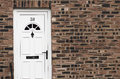 White Front Door Of A Red Brick English Town House. Manchester. Stock Image - 65804961