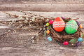 Easter Eggs In Small Nest And Willow Branch On Wooden Background Stock Photography - 65837152