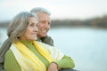 Happy Senior Couple  Near River Stock Photography - 65853892