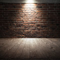 Wooden Floor And Red Brick Wall With Spot Light Royalty Free Stock Photography - 65865027