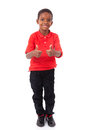 Portrait Of A Cute African American Little Boy Making Thumbs Up Stock Images - 65865434