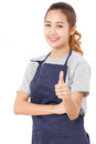 Asian Woman Wearing Apron And Showing Thumbs Up. Stock Images - 65866274