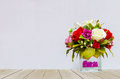 Beautiful Multi Color Of Roses In Glass Flowerpot At The Corner On Wooden Table With Gray Background Stock Photos - 65870893