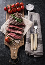 Grilled Beef Steak With Rosemary And Salt Stock Photos - 65881803