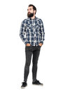 Serious Bearded Hipster In Checked Plaid Shirt With Hands In Pockets Looking Away Stock Photo - 65897370