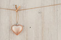 Heart Hanging On The Clothesline. On Old Wood Background Stock Images - 65905734