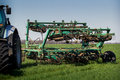 Weeding-machine Behind Tractor On Green Wheat Field Royalty Free Stock Photos - 65910328