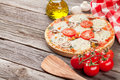 Pizza With Tomatoes And Mushrooms Royalty Free Stock Image - 65924926