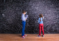 Cute Little Boy And Girl In Front Of A Big Blackboard. Royalty Free Stock Images - 65958629