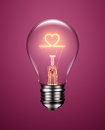 Light Bulb With Filament Forming A Heart Icon Royalty Free Stock Photography - 65960027