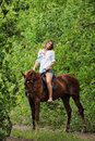 Woman Riding Horseback Through Forest Royalty Free Stock Image - 65973616