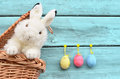 Happy Easter Bunny In Basket And Eggs On Blue Background. Stock Image - 65983691