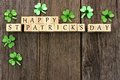 Happy St Patricks Day Wooden Blocks With Shamrocks Over Wood Royalty Free Stock Photo - 65995615