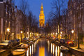 Church And A Canal In Amsterdam At Night Stock Images - 66009414