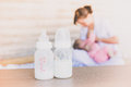 Milk Storage Bottle On Blurred Mothers Breast Milk Is Most Healthy Food For Newborn Baby Bester Food Stock Photography - 66022432
