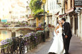 Happy Married Couple Bride And Groom Kissing & Hugging In Old Fr Stock Image - 66025991