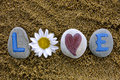 Love Spell Out From Stones With Letters, Heart And Flower Stock Photography - 66038492