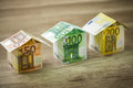 Houses Made Of Euros Currency Banknotes Royalty Free Stock Photos - 66053038