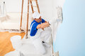 Painter Painting A Wall With Paint Roller Royalty Free Stock Photography - 66064097