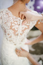 Bride Getting Dressed On Her Wedding Day Royalty Free Stock Photos - 66067778