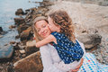 Portrait Of Happy Mother And Daughter Spending Time Together On The Beach On Summer Vacation. Happy Family Traveling, Cozy Mood. Royalty Free Stock Photo - 66076295