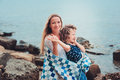 Happy Mother And Daughter Wrapped In Quilt Blanket Spending Time Together On The Beach On Summer Vacation. Happy Family Traveling Royalty Free Stock Photo - 66076305