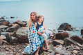 Happy Mother And Daughter Wrapped In Quilt Blanket Spending Time Together On The Beach On Summer Vacation. Happy Family Traveling Royalty Free Stock Image - 66076326