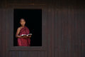 Novice Monk Smiles At The Old Temple Window Stock Photo - 66084150