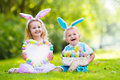 Kids On Easter Egg Hunt Stock Photography - 66092172