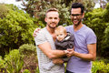 Smiling Gay Couple With Child Stock Photography - 66095392