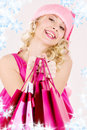 Cheerful Santa Helper Girl With Shopping Bags Royalty Free Stock Image - 6615466