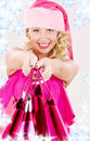 Cheerful Santa Helper Girl With Shopping Bags Stock Image - 6615551