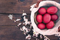 Basket With Easter Cake And Red Eggs On Rustic Wooden Table. Top Royalty Free Stock Photo - 66112765