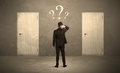 Businessman Standing In Front Of Doors Royalty Free Stock Images - 66133569