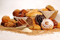 Composition With Bread And Rolls In Wicker Basket, Combination Of Sweet Pastries For Bakery Or Market With Wheat Stock Photography - 66148332